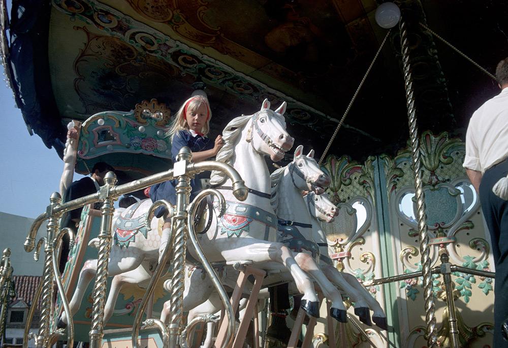 girl-on-carousel.jpg